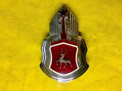 Знак капота заводской в сборе